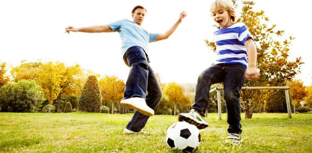 father-son-park-soccer