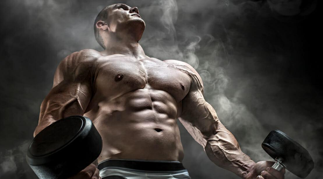 Bodybuilder Holding Dumbbells